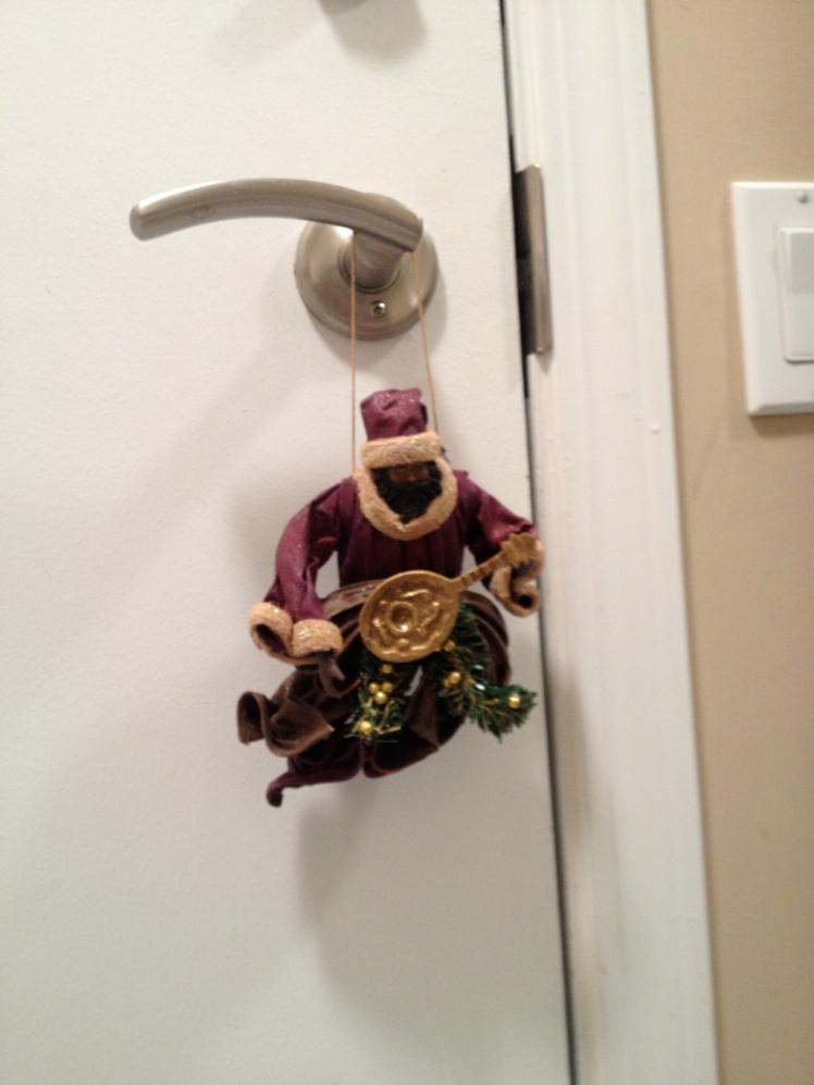 Andy's favourite ornament. Black, musician Santa.