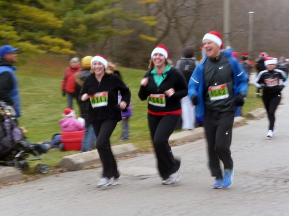 Leslie completing her first 5K, with running companions, Lisa and Paul.