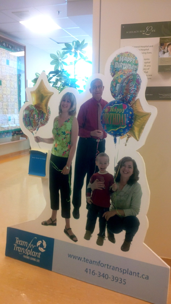 Dad in the background, holds balloons to celebrate miracle birthdays with other transplant recipients.