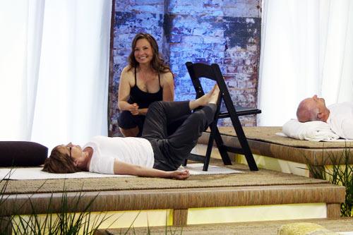 Deborah Devine demonstrates a movement on a show participant