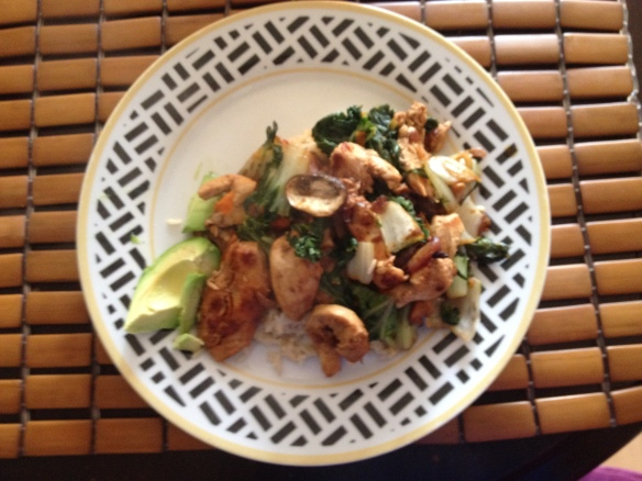 Chicken breast stir fry with baby bok choy and brown rice. Avocado on side.