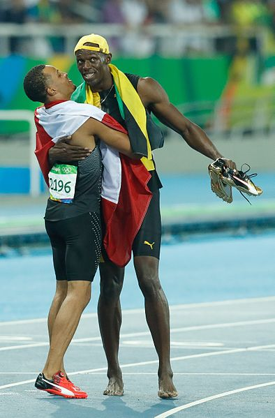 394px-De_Grasse_and_Bolt_Rio_100m_final_2016